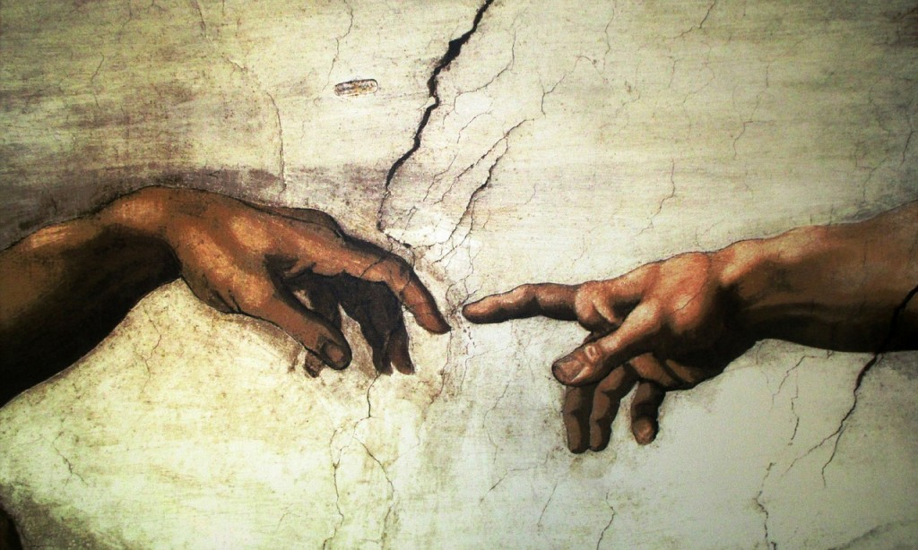 A Michelangelo painting depicting two outstretched arms, symbolising the similarities yet differences between Life Insurance and Critical Illness