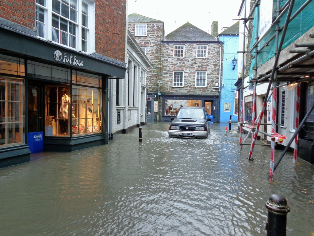 Flood water in Fowey causing flooding to shops and offices - a reason to have great Office and Premises Insurance